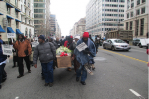 Casket being carried from Freedom Plaza to NY Ave. Presbyterian Church for Memorial Service